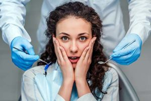 young woman suffering from dental anxiety