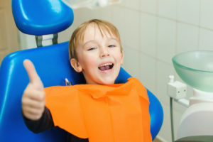 kid with thumbs up after dental bonding