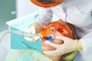 woman receiving dental fillings and sealants