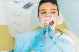 kid receiving pediatric dentistry services